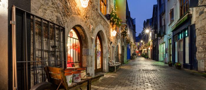 Galway, Ireland - old street decorated with christmas lights at night